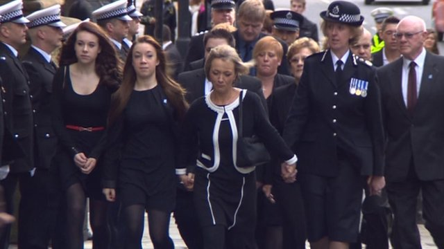 Northumbria Police chief constable Sue Sim holds hands with Kath Rathband, the widow of PC David Rathband