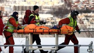 Rescuers bring a survivor to Tromso&#039;s hospital