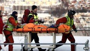 Rescuers bring a survivor to Tromso's hospital