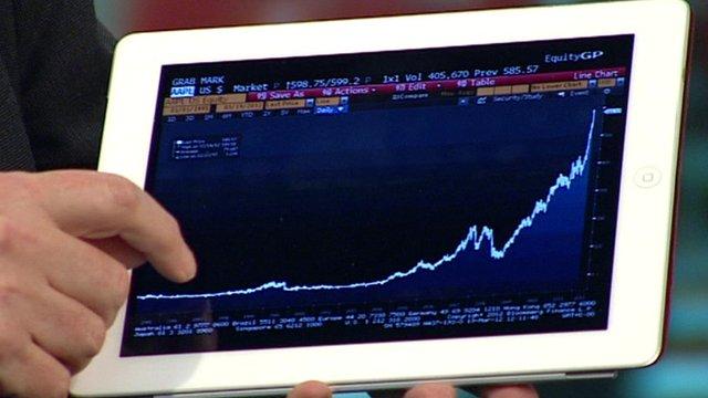 The BBC's Rory Cellan-Jones holds an iPad