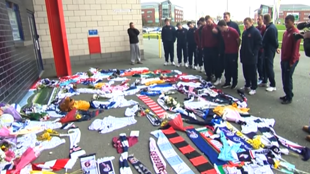 Sunderland players visit the Reebok Stadium to place a shirt for Fabrice Muamba.