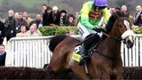 Jockey Ruby Walsh jumps the last on Kauto Star to win the Cheltenham Gold Cup Chase in 2009