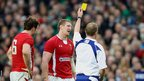 Wales lock Bradley Davies is shown the yellow card by referee Wayne Barnes after a tip tackle on Ireland's Donnacha Ryan