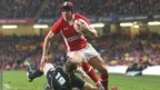 Wales back Leigh Halfpenny makes the most of the extra space to cross for the first of his two tries