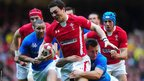 Wales wing George North breaks from the tacke of Italy's Mirco Bergamasco during the Six Nations clash at the Millennium Stadium