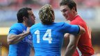 Italy's Luke McLean clashes with North following a robust tackle by the Wales wing