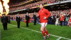 Hooker Matthew Rees, leads Wales on to the Millennium Stadium pitch ahead of the match against France.