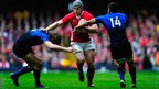 Wales centre Jonathan Davies runs at the France defence during the first half