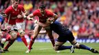 Wales scrum-half Mike Phillips is tackled by France's Pascal Pape
