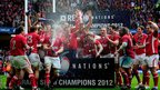 Wales celebrate the Grand Slam with champagne - captain Sam Warburton holding the Six Nations trophy aloft while nursing an injured right shoulder sustaned during the win over France