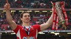 Wing George North shows off the Six Nations trophy to the Welsh supporters