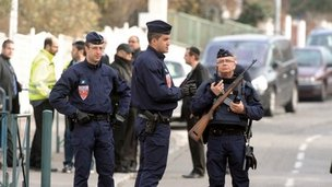 Policemen stand guard in front of the Ozar Hatorah school in Toulouse on 20 March