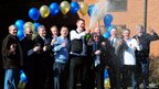 The syndicate of bus drivers who won £38m in the Euromillions lottery celebrate with champagne in Corby, Northamptonshire