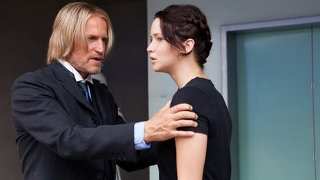 Haymitch Abernathy (Woody Harrelson) and Katniss Everdeen (Jennifer Lawrence) in The Hunger Games. Photo credit: Murray Close