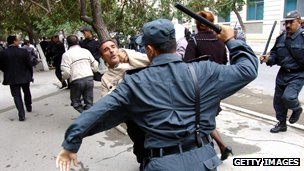 Police beating demonstrators in Baku