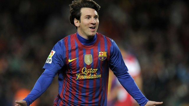 Barcelona&#039;s Lionel Messi celebrates after breaking the record