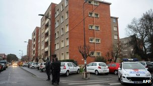 French police near the Toulouse apartment where the suspect in the killing of seven people is surrounded - 21 March 2012
