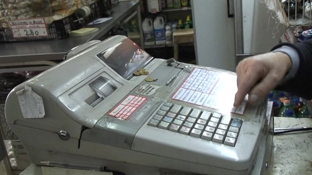 Cash register in small food shop