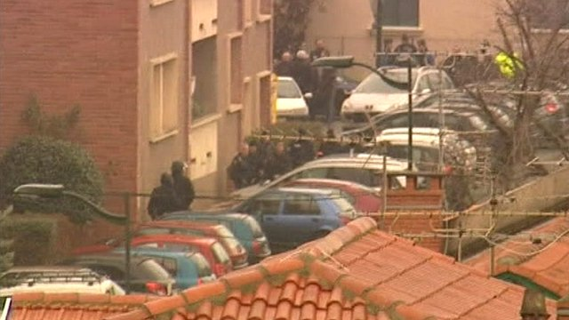 French police officers gathered near apartment
