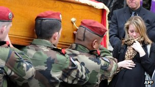 Soldiers carry coffin of Paratrooper killed in attack near Toulouse