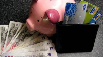 Money, credit cards and a piggy bank