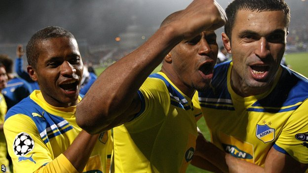Apoel Nicosia players celebrate beating Lyon