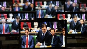 Televisions showing Chancellor George Osborne delivering the Budget