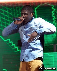 Labrinth performs on stage