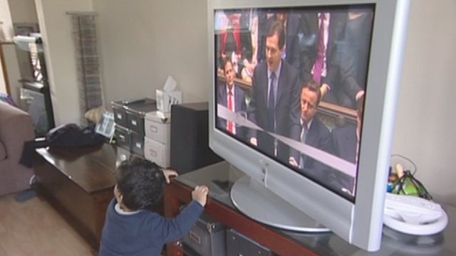 Child in London watching the Budget on TV