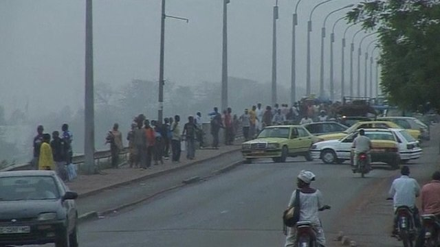 cars turning around on a bridge in Mali