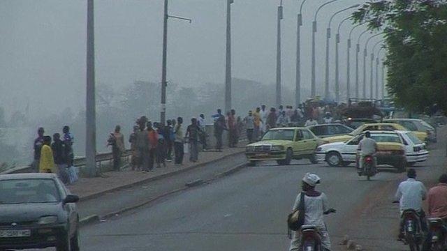 cars turning around on a bridge in Mali