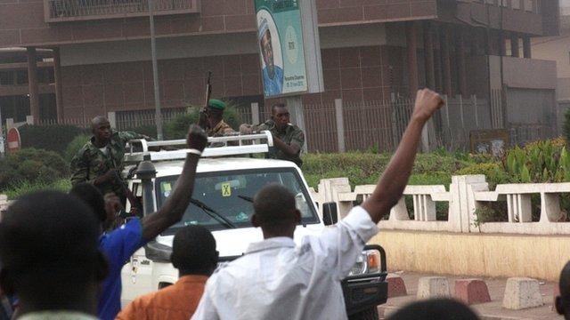 Civilians cheer as rebel soldiers drive past in Bamako, Mali
