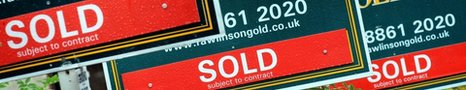 Housing sold signs