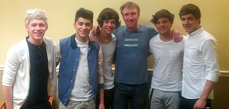 Matt Wells, in blue, with One Direction