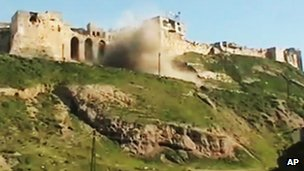 This still from an amateur video purports to show a castle being shelled in Hama