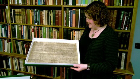 Archivist Ellie Jones with Edward the Confessor's Charter