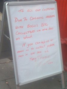 Sign explaining charity bags are being stolen