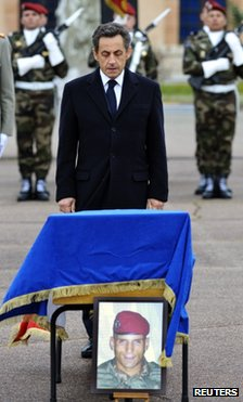 French President Nicolas Sarkozy  stands in front of the coffin of  Mohamed Legouad in Montauban, 21 March