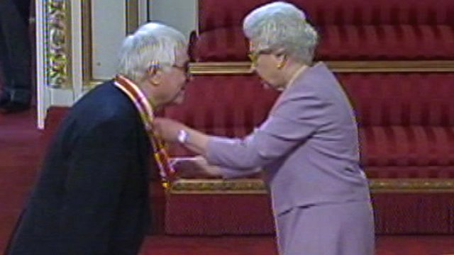Sir Bob Russell receives his knighthood from the Queen