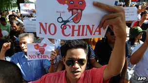 Vietnamese protesters shout anti-China slogans during a rally in the centre of Hanoi on 14 August 2011