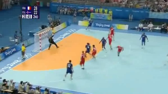 The French handball team score a goal on the pitch
