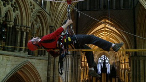 Jonathan Foyle suspended inside Lincoln Cathedral