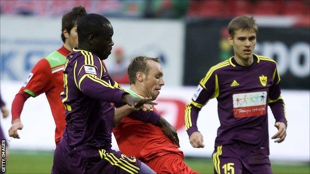 Purple-clad Chris Samba (left) in action against Lokomotiv Moscow