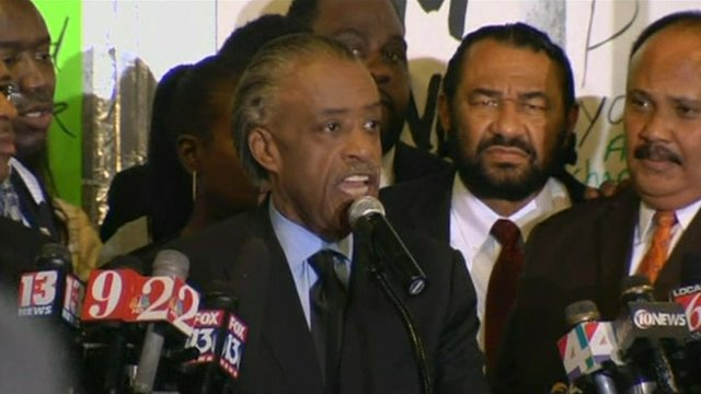 Reverend Al Sharpton speaks to a rally