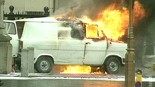 Van on fire following the attack on 10 Downing Street