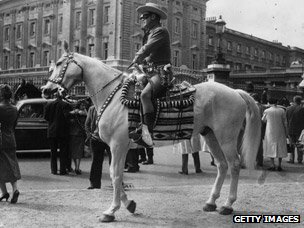 The Lone Ranger, aka actor Clayton Moore, visits the Horse Guards on parade at Buckingham Palace