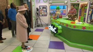 The Queen on the set of CBBC with puppets Hacker & Dodge