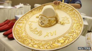 A wide brimmed white and gold Mexican hat