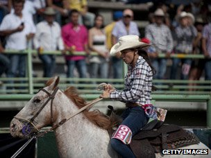 Cowgirl competing in a rodeo