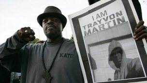 "A protester in Los Angeles holds a sign reading ""I am Trayvon Martin"", Los Angeles, California 23 March 2012"